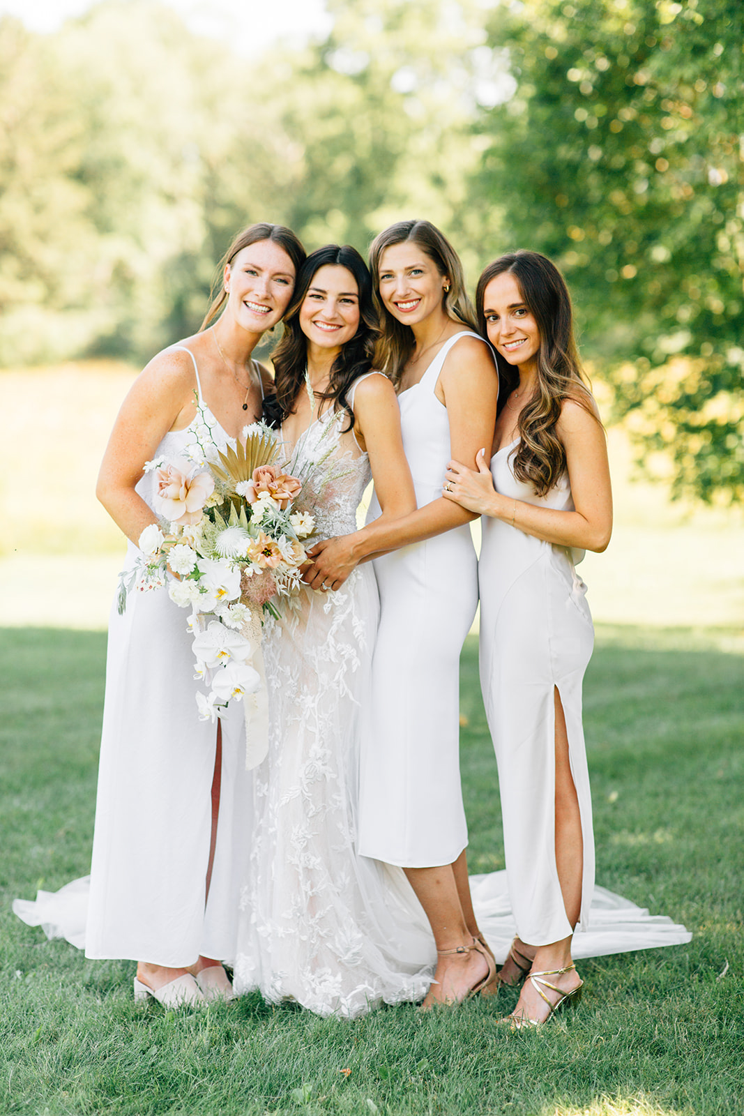 bride and bridesmaids in white dresses in outdoor