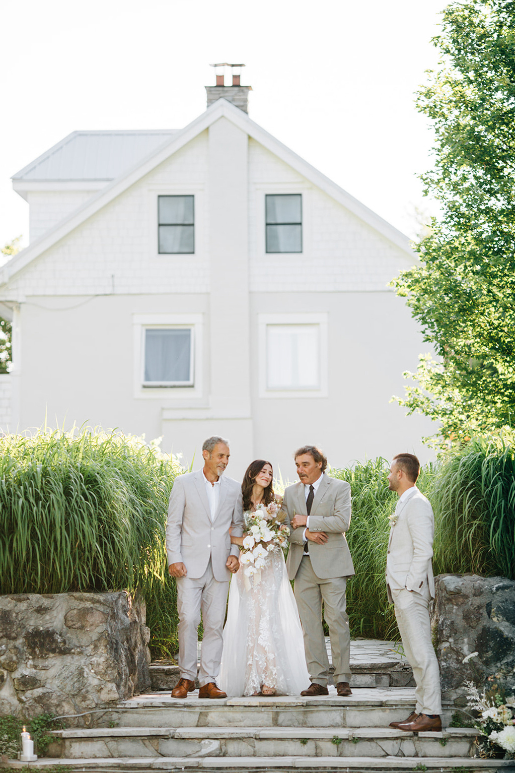 bride with fathers walking down aisle