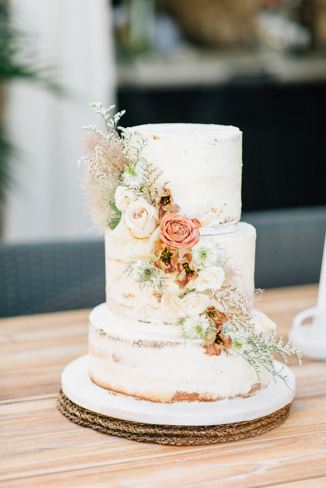 white wedding cake with white and pink flowers