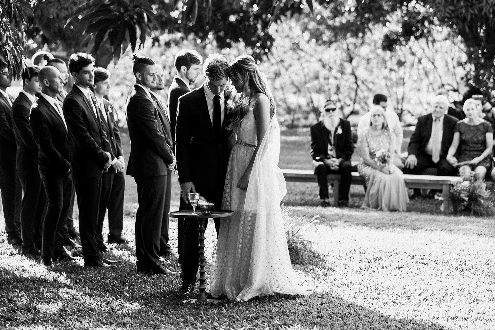 couple standing together for quiet moment during outdoor wedding ceremony