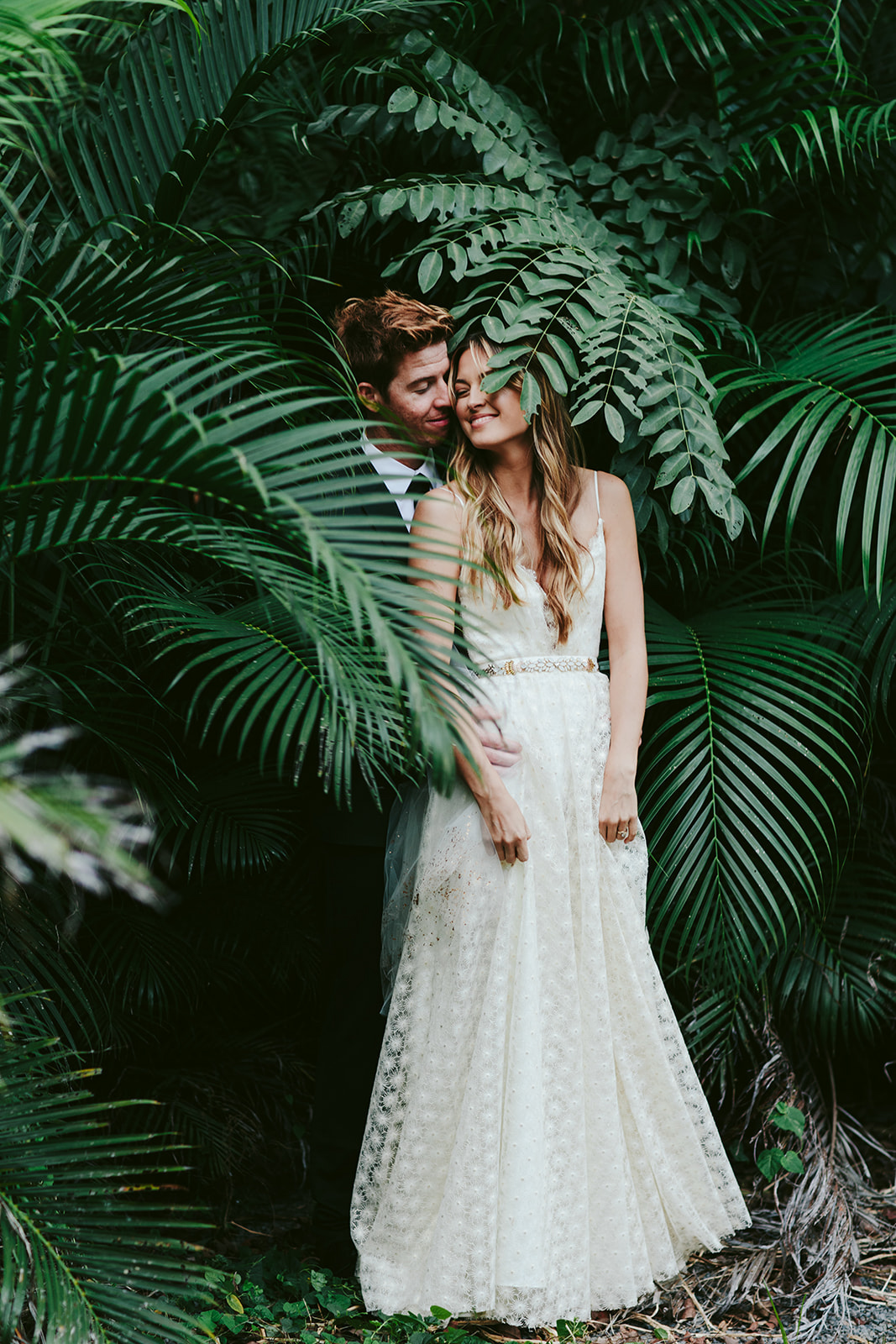 wedding couple portrait with lush tropical greenery background