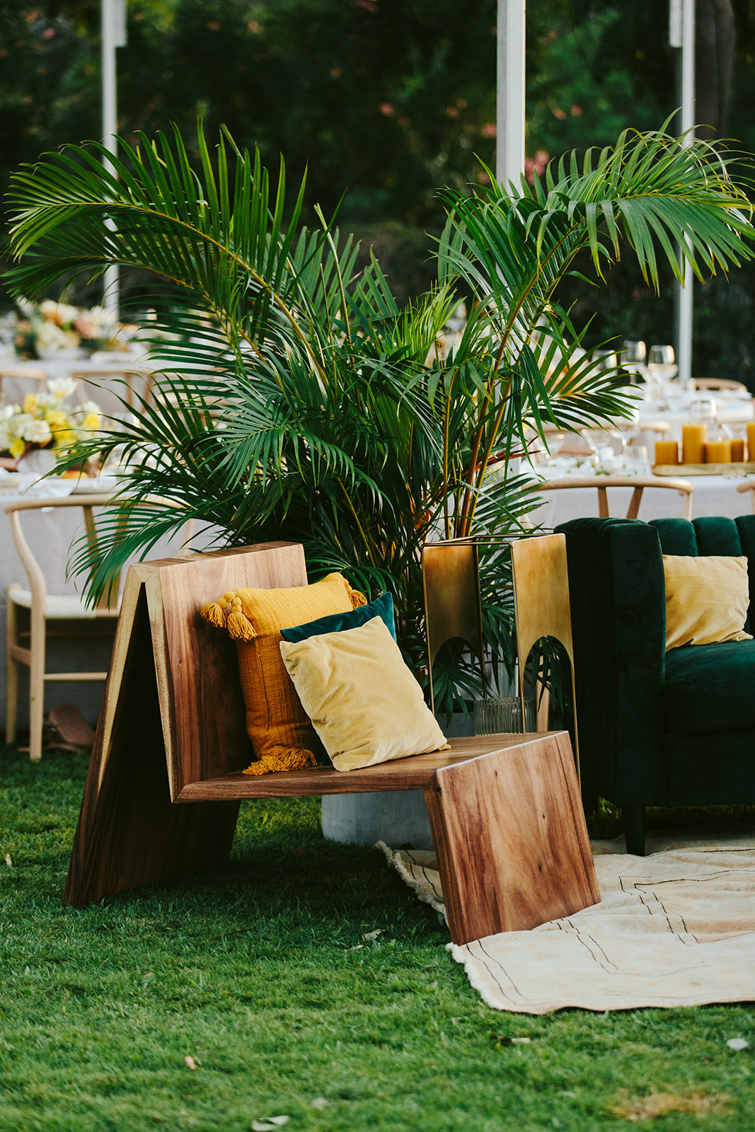 elegant wedding lounge in mustard and emerald with tropical greenery