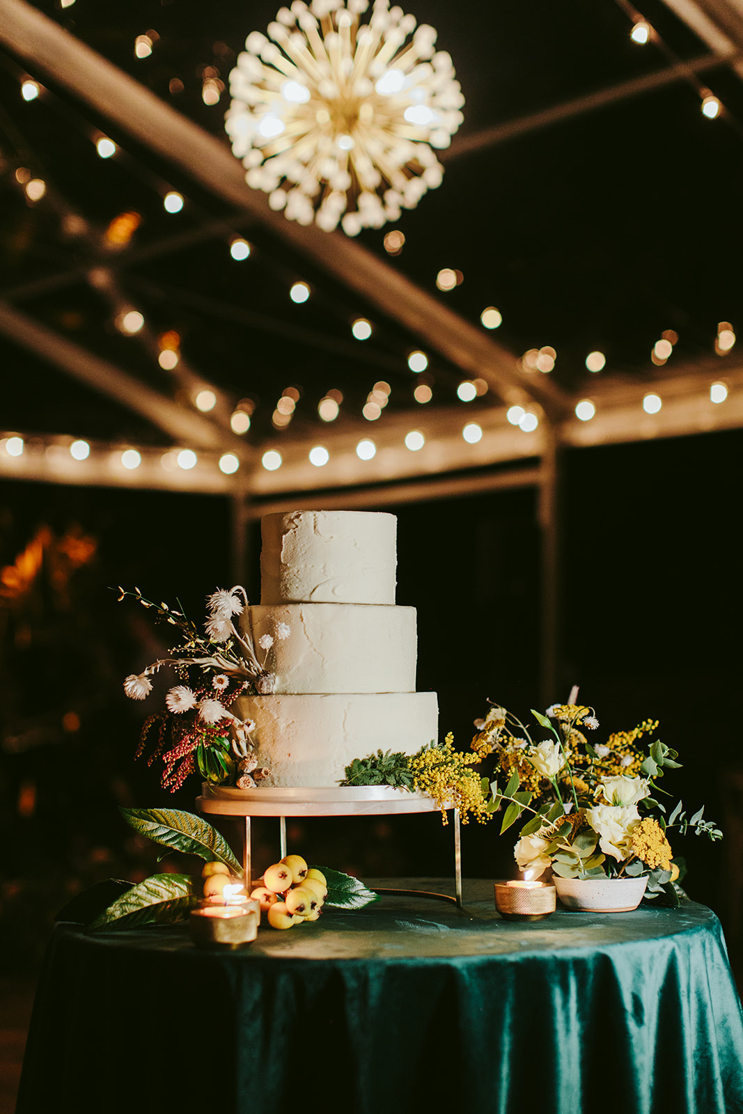 three-tiered simple wedding cake with florals