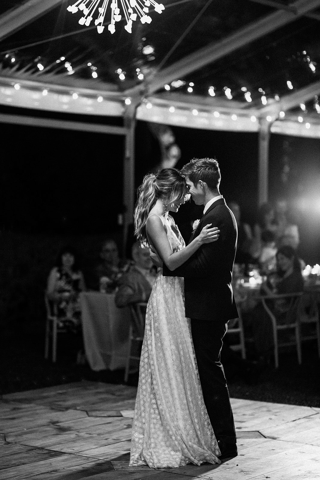 couple during first dance on wooden floor