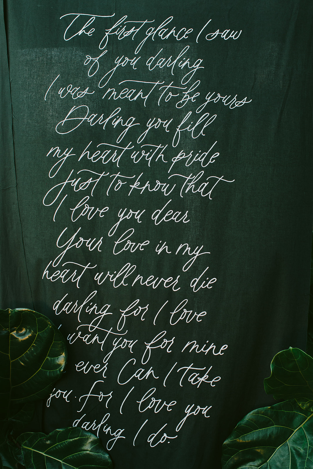 scripted quote on green wall at reception