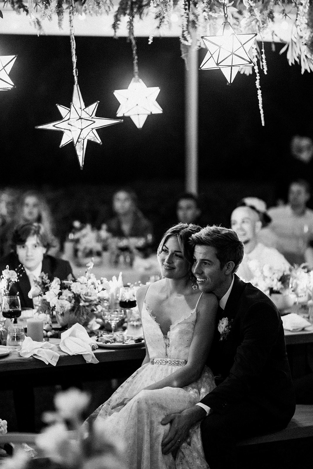 couple sitting together during speeches at reception