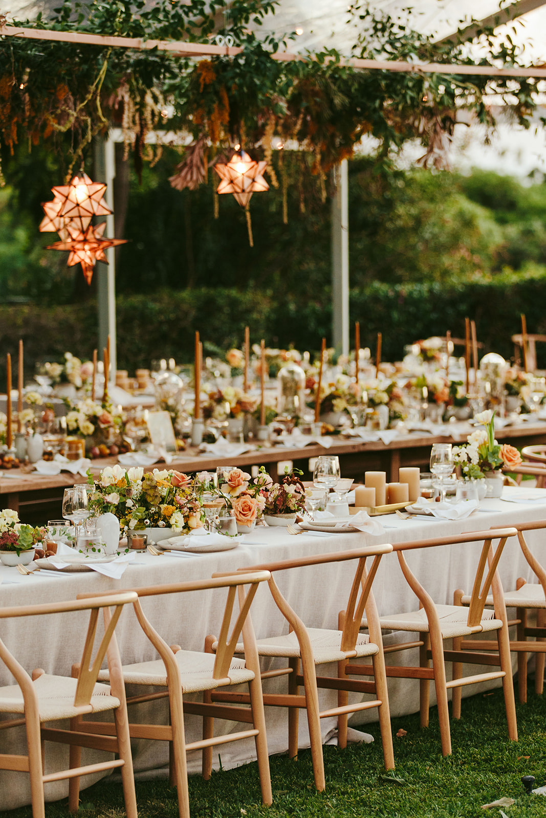 cloth-covered long wedding reception tables with florals