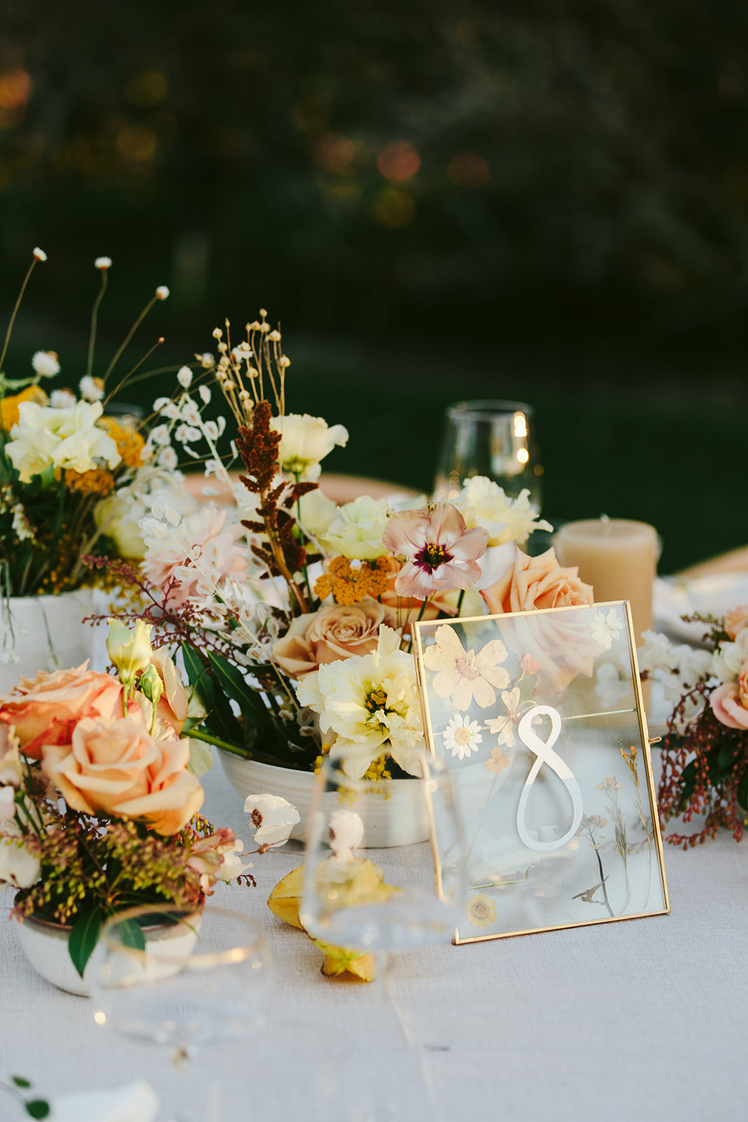 clear table numbers with mustard, coral, and gold floral accents