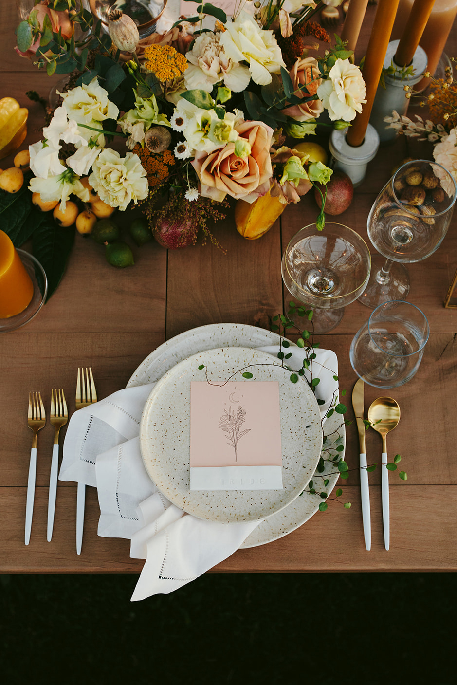 mustard and coral elegant place settings for wedding reception