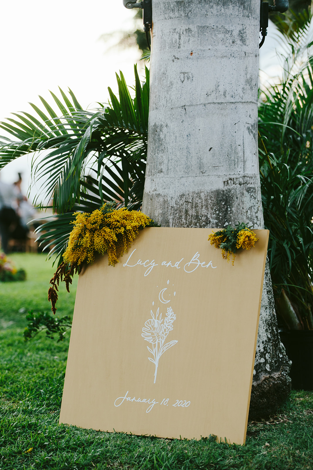 mustard colored wedding sign with flowers