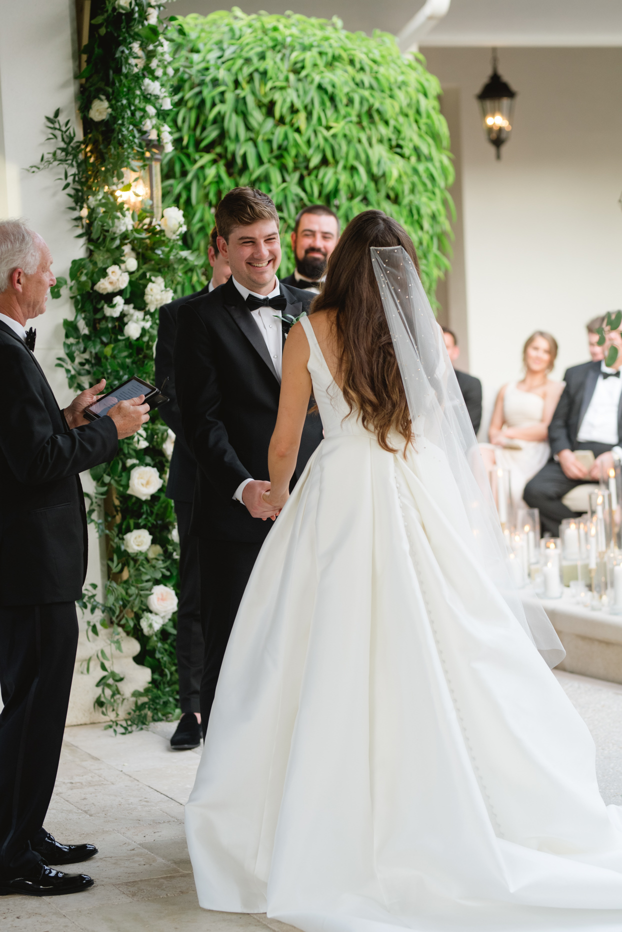 couple smiling and holding hands for outdoor wedding ceremony
