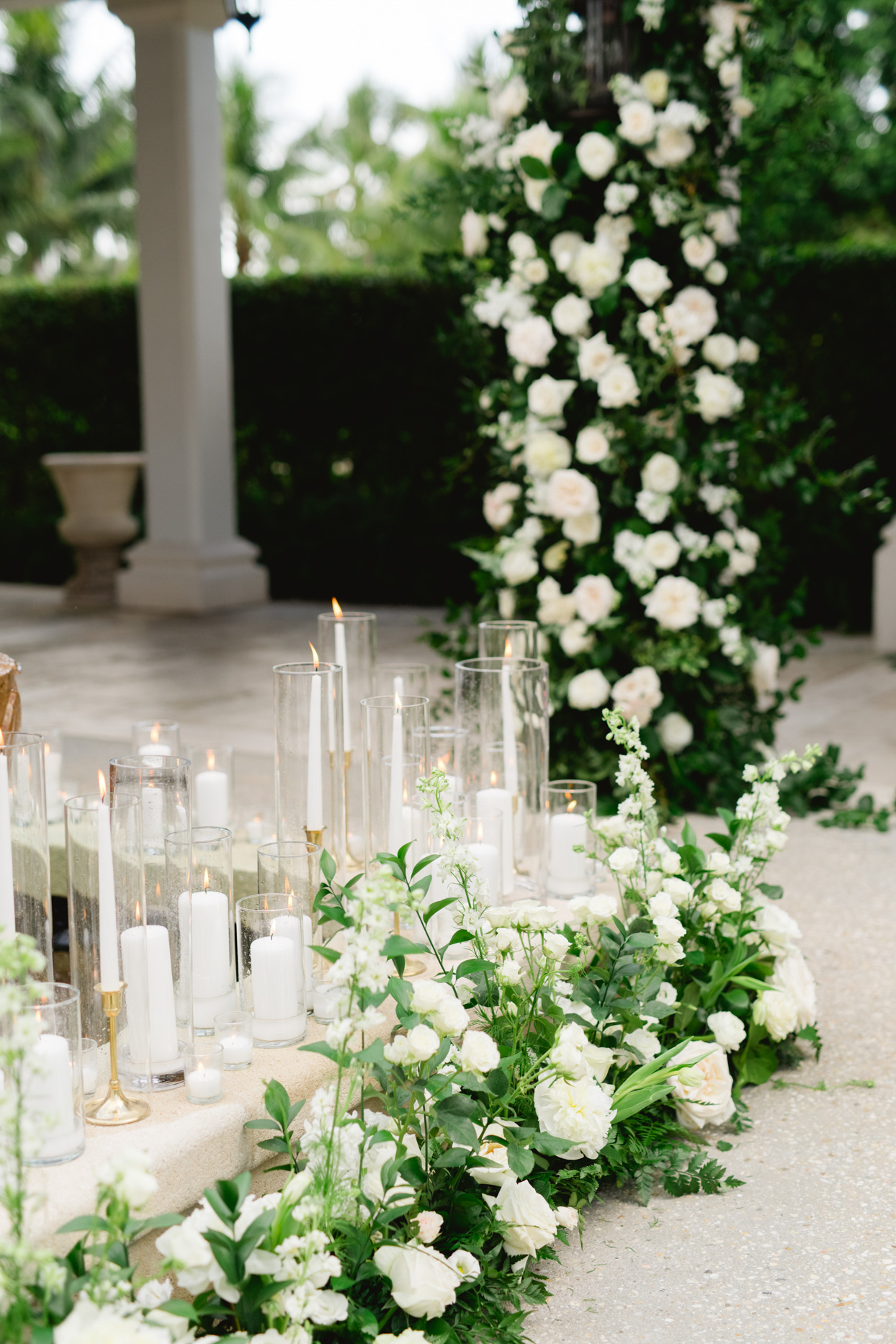 candles on stone walkway with white florals