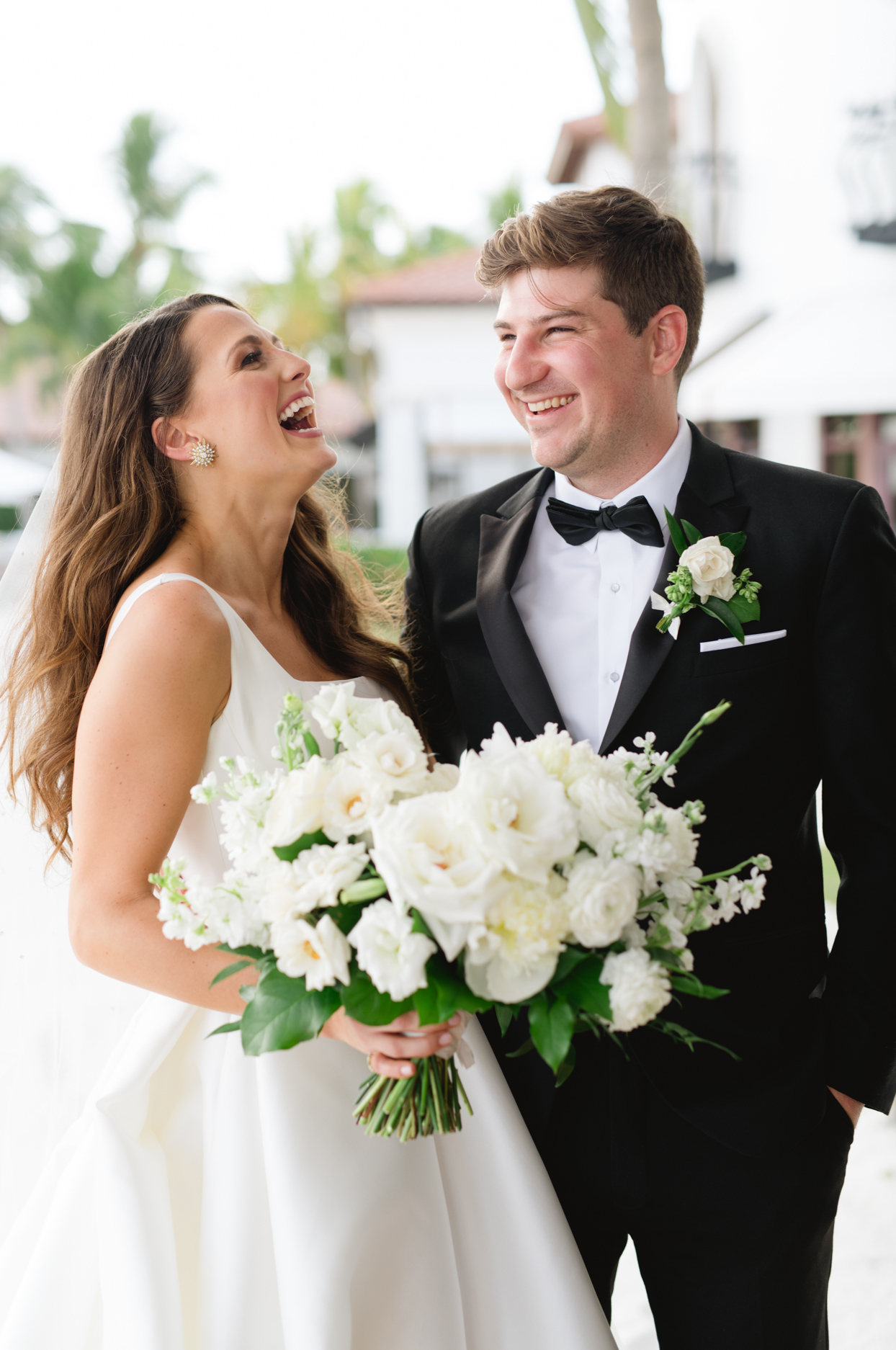 couple portrait outdoors laughing