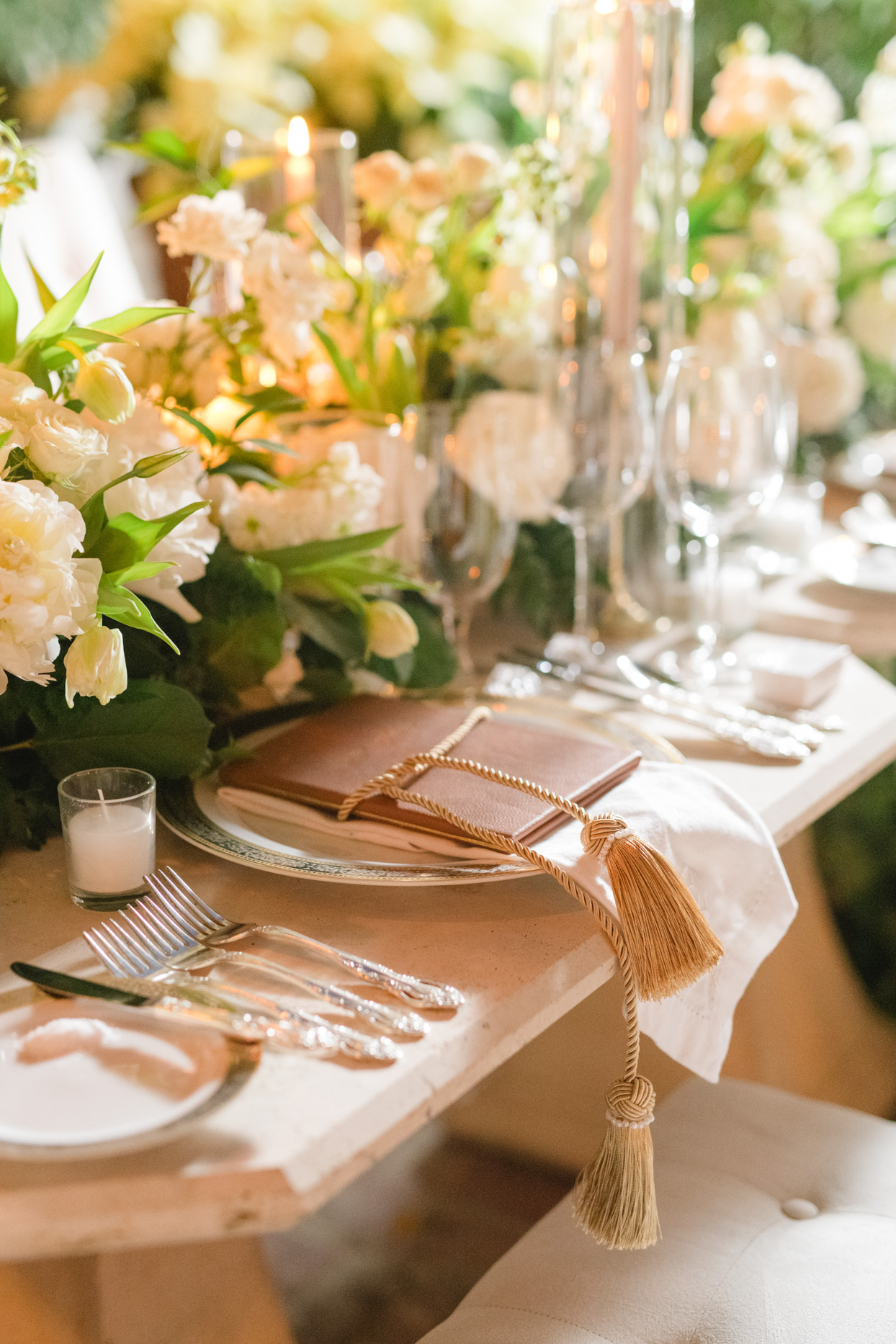 elegant reception place setting with tassels on napkins