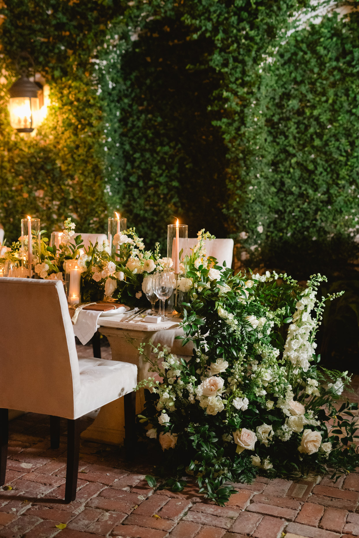 wedding reception table with floral garland