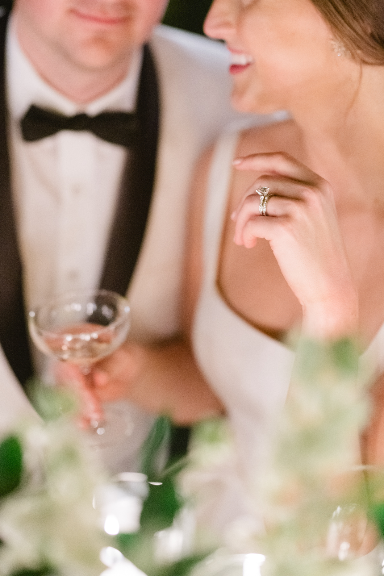 bride holding out hand with large diamond ring on it