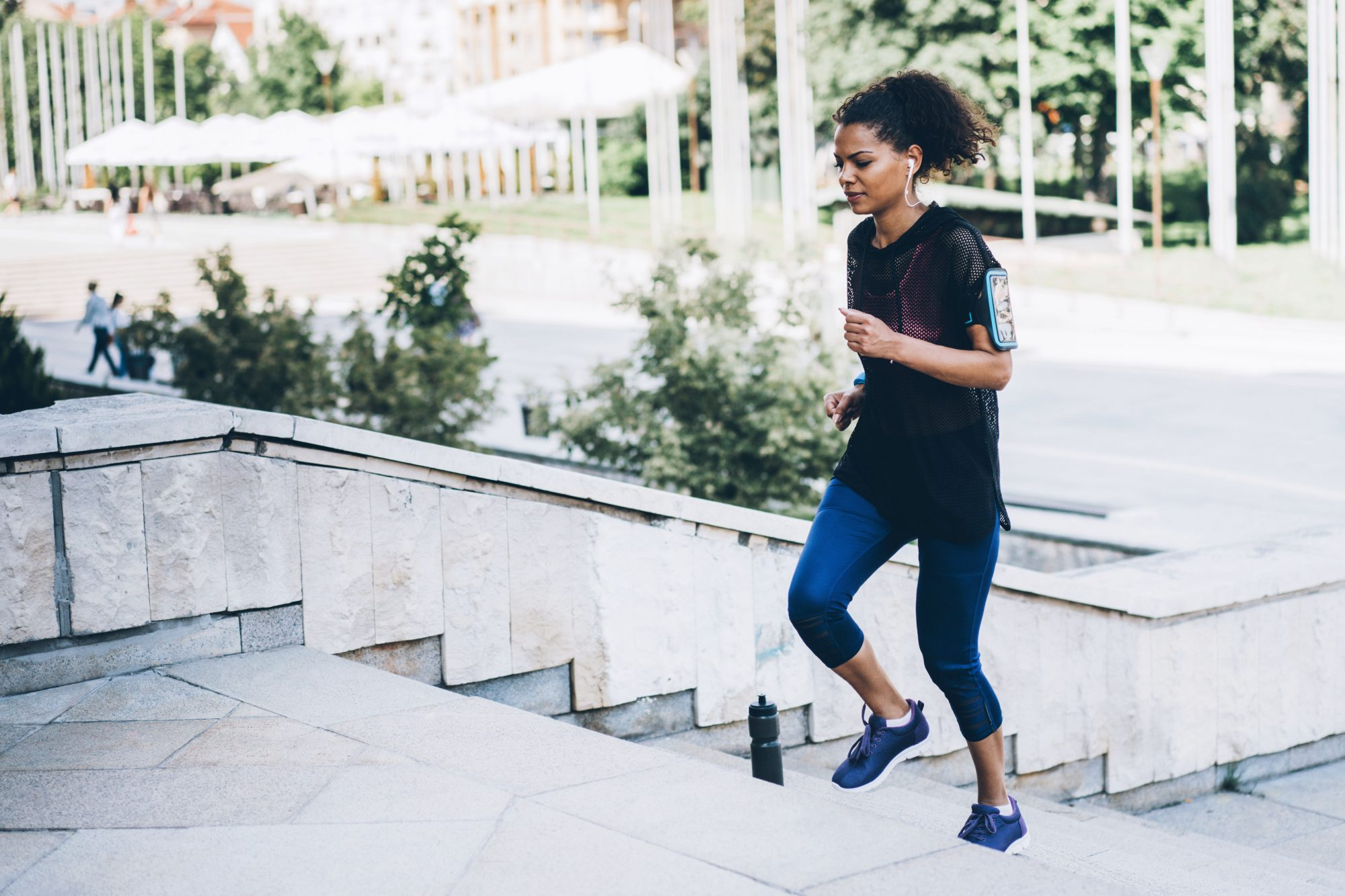 woman exercising on stairs outdoors