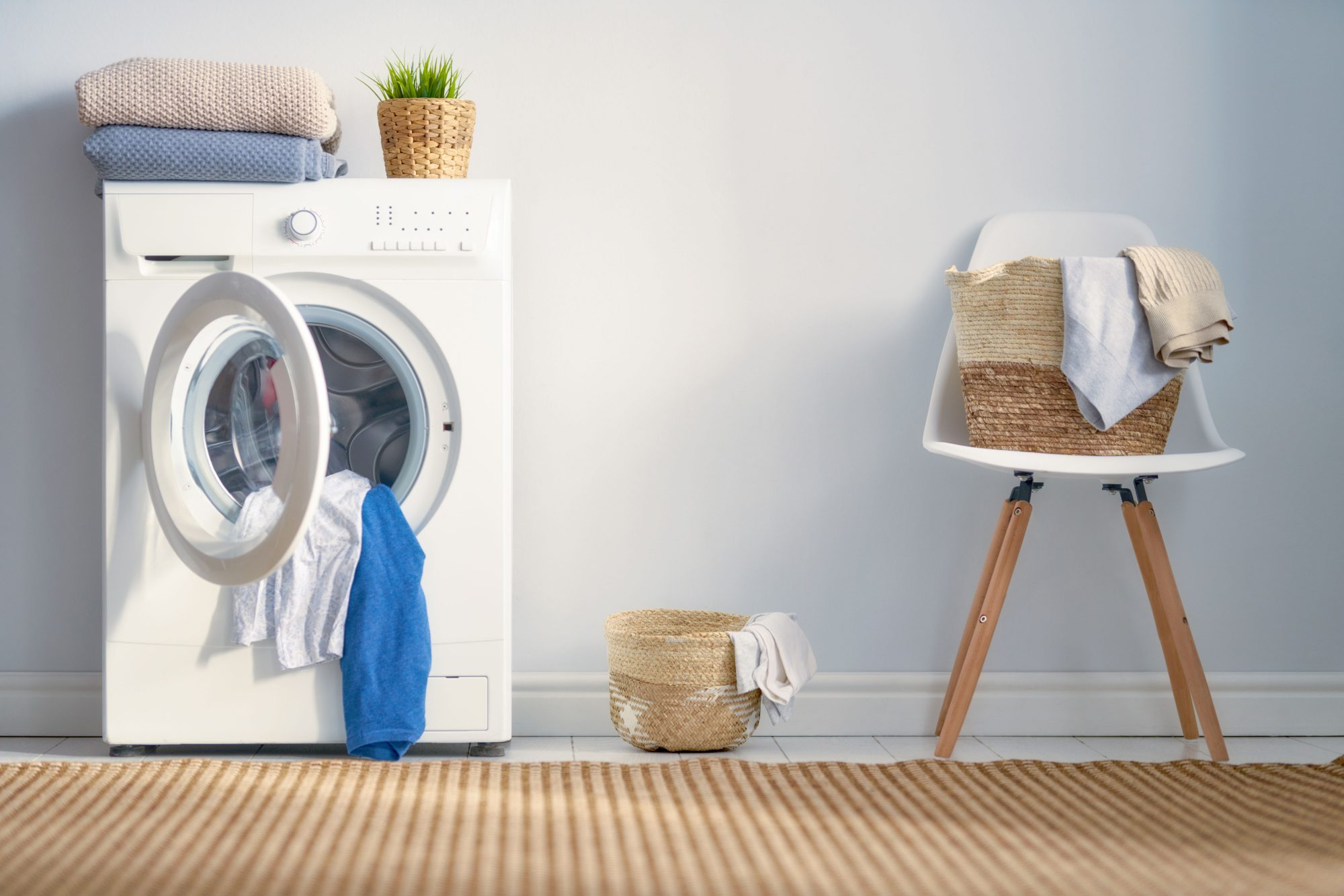 open washing machine with clothes
