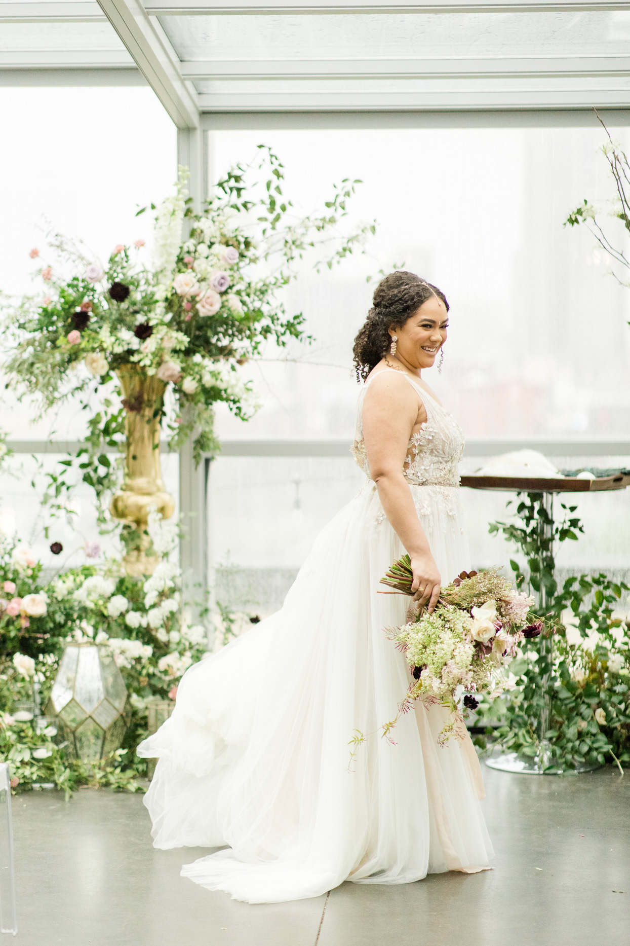 bride holding bouquet for rooftop wedding
