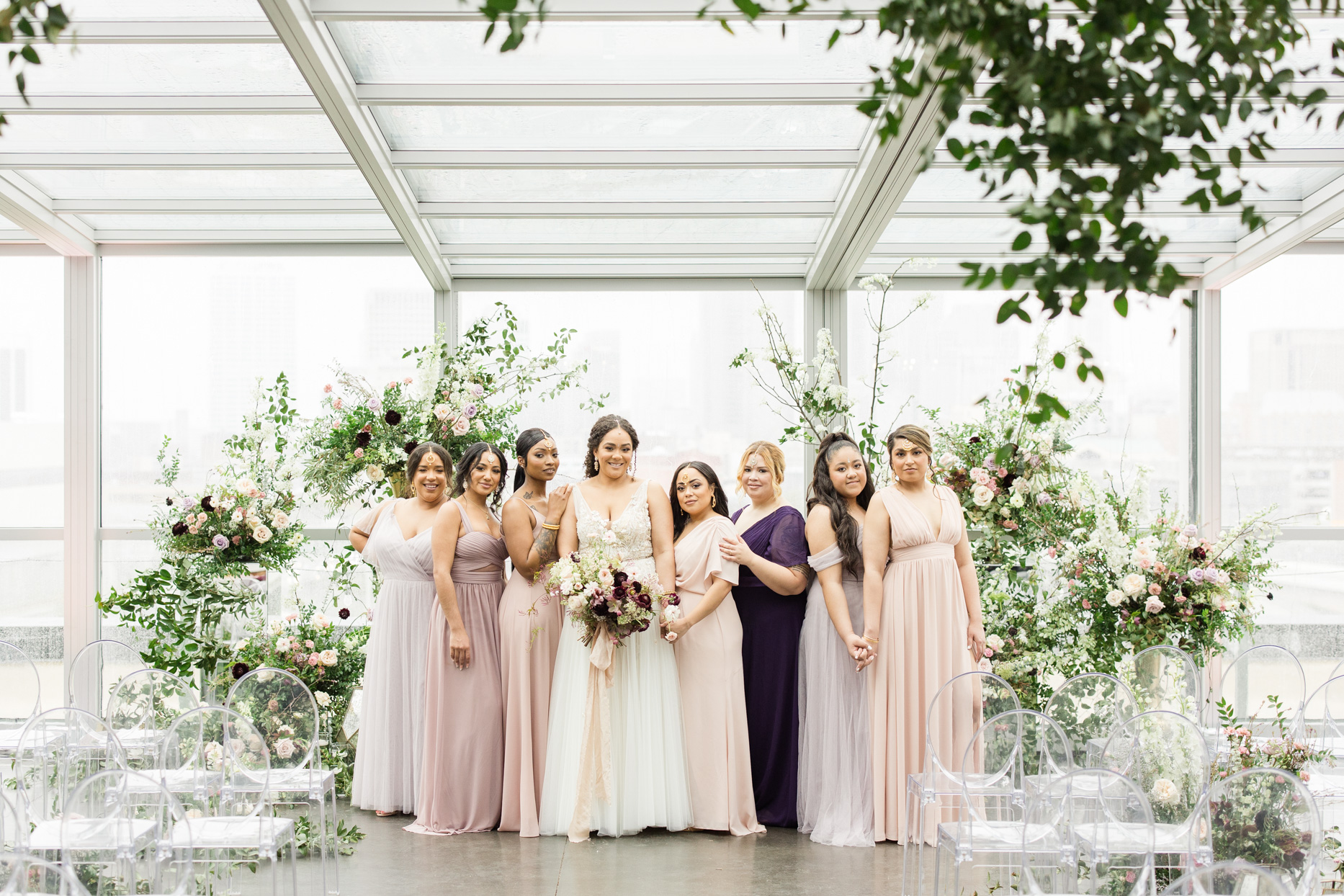 bridesmaids in shades of pink and purple at ceremony location