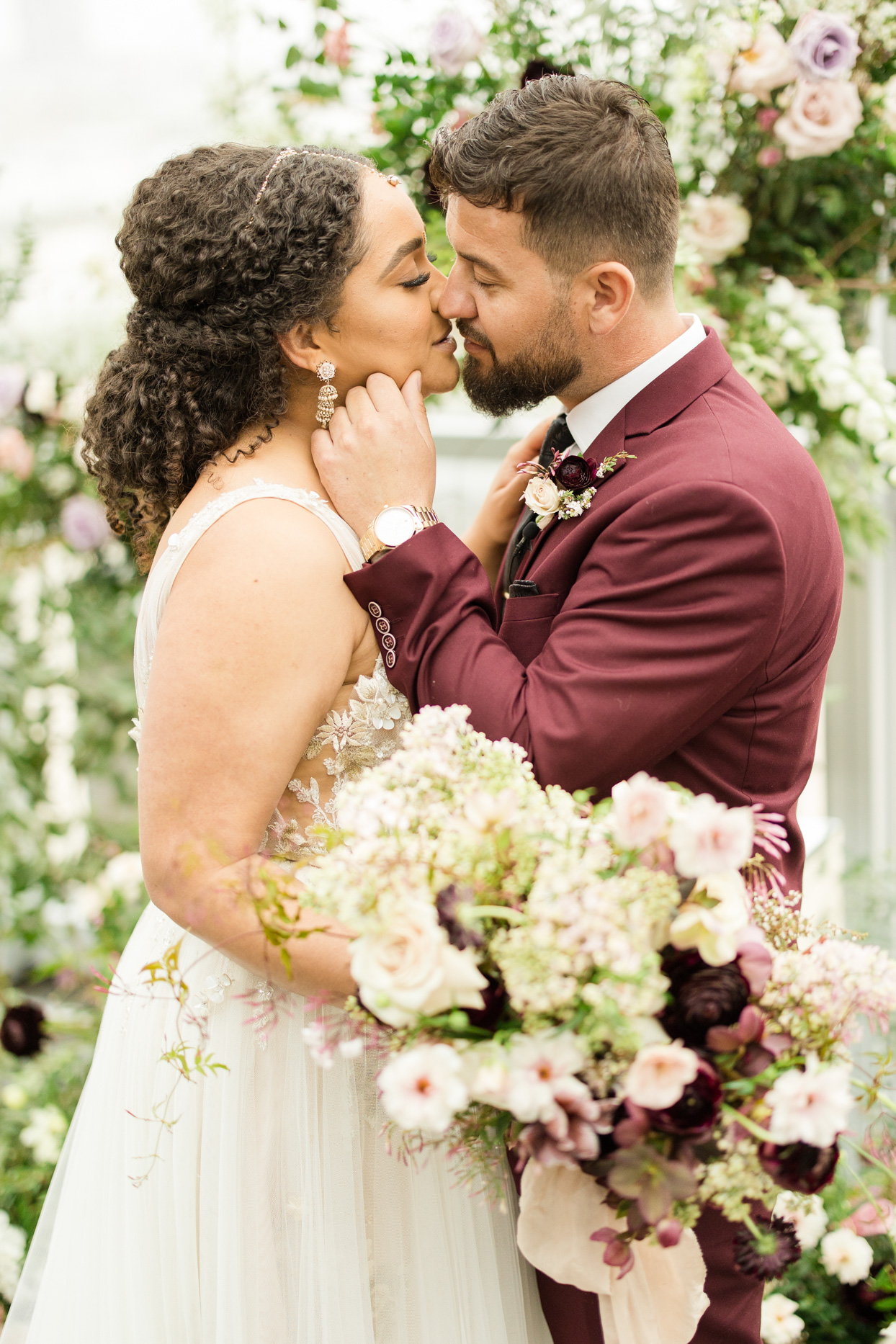 wedding couple in white and maroon