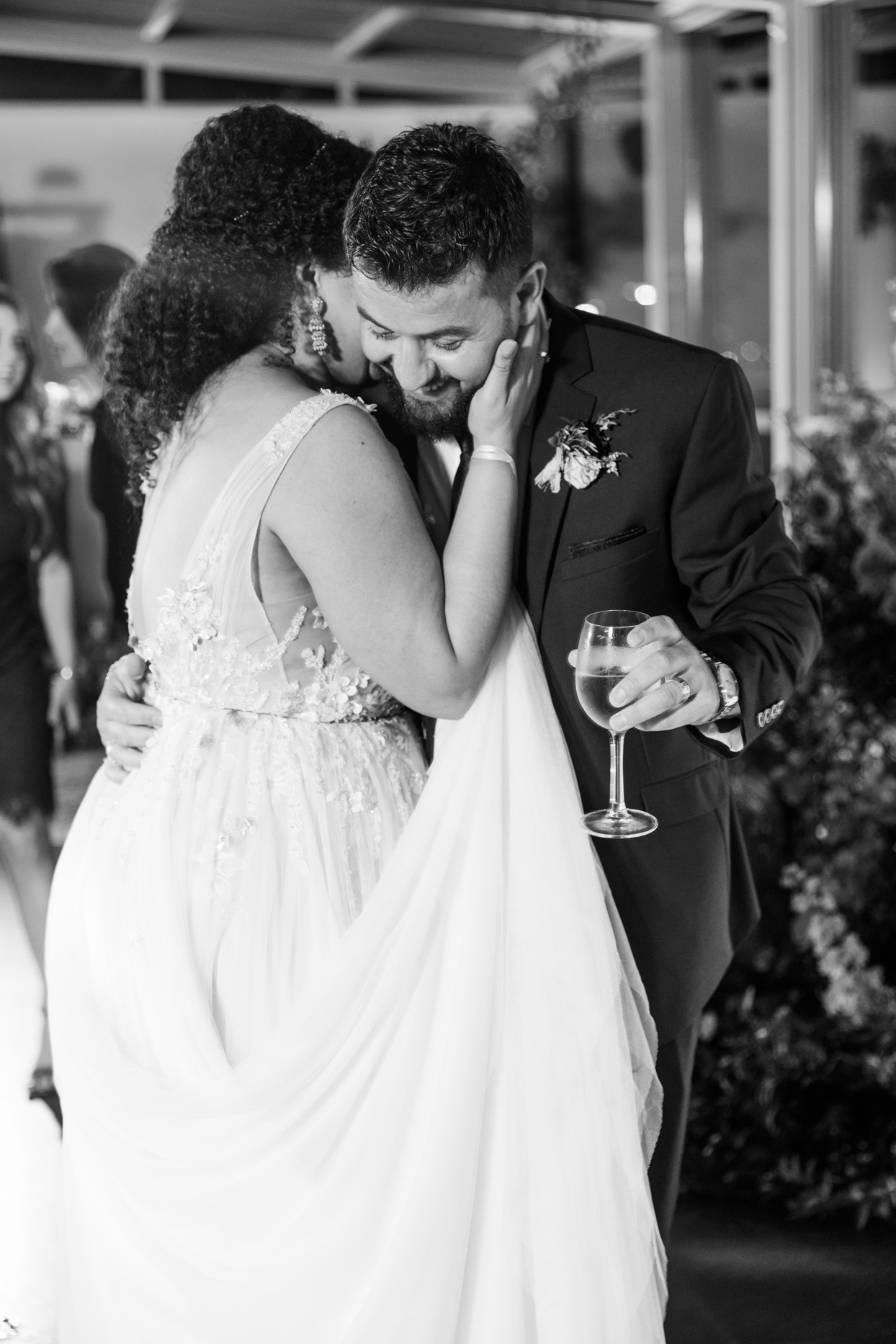 couple embracing during wedding reception