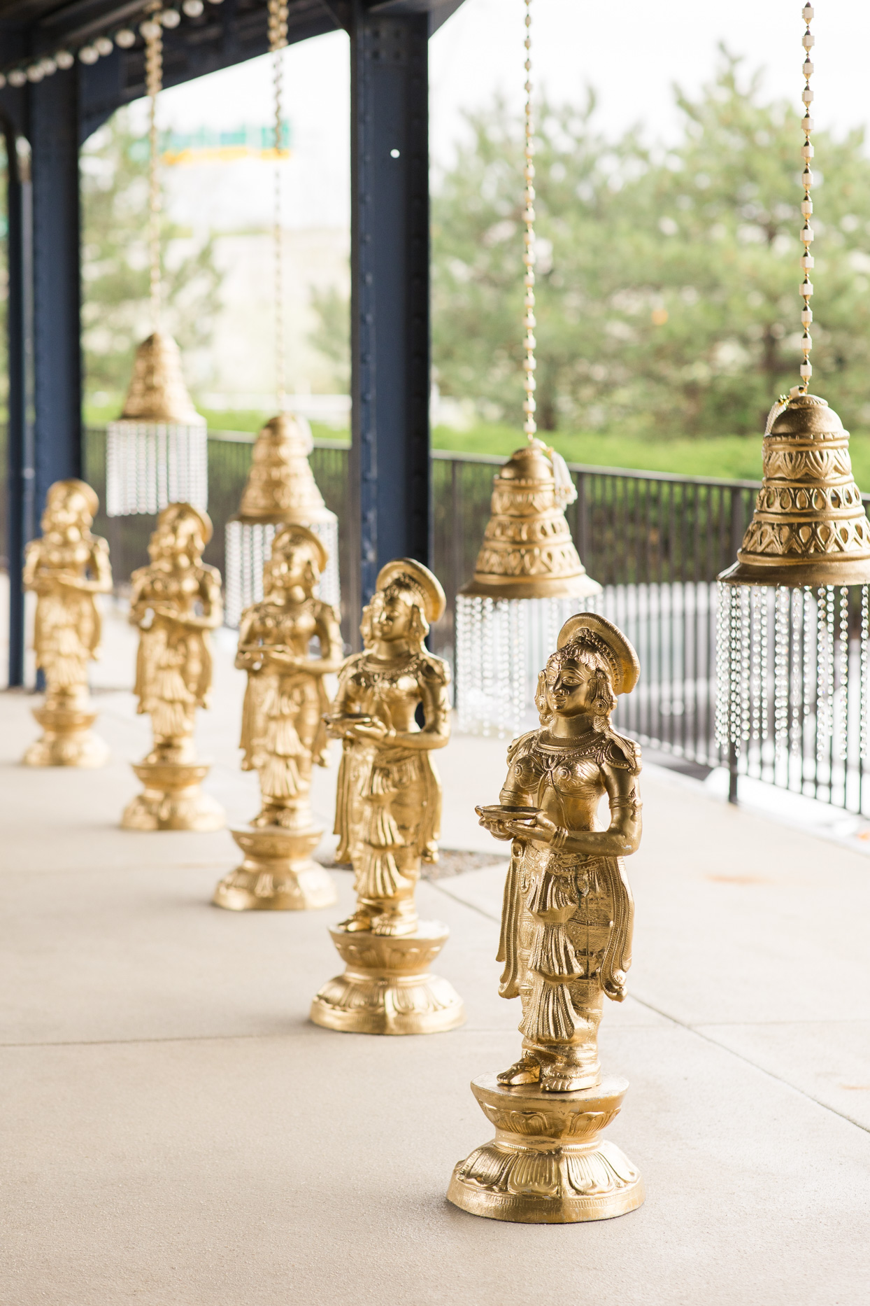 golden statues at wedding ceremony