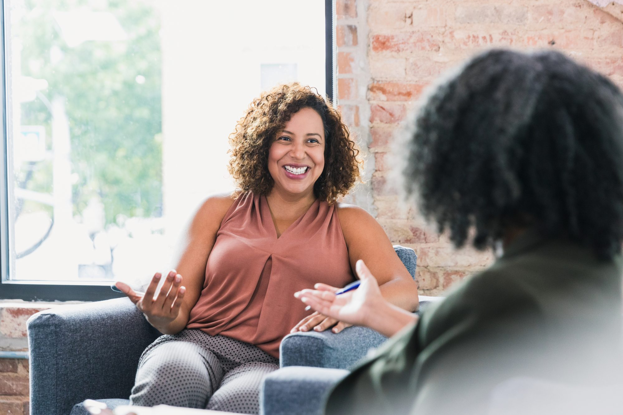 woman speaking with therapist in office