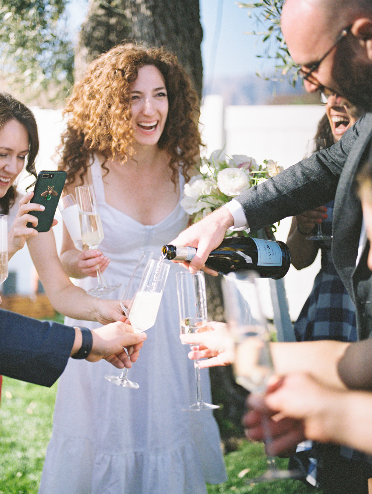 wedding guests pouring champagne