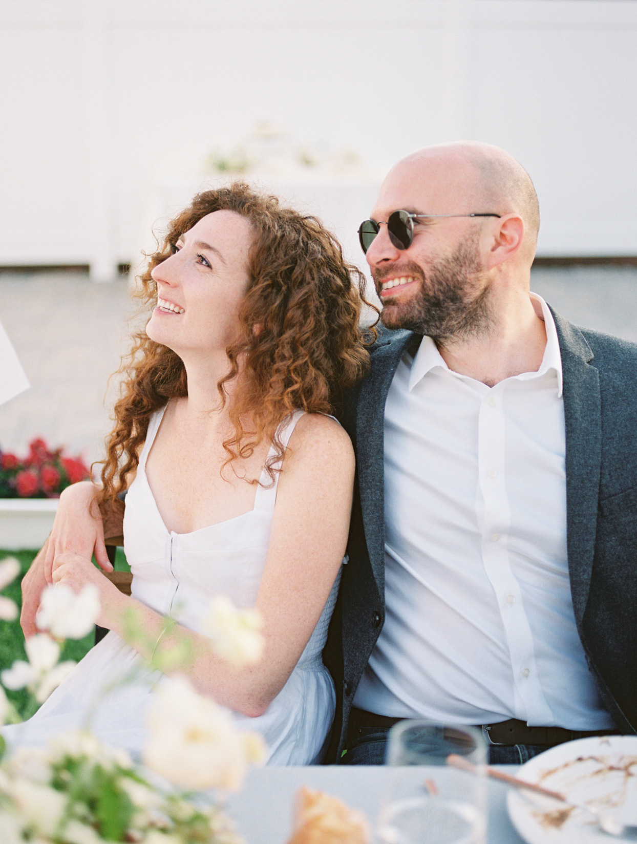 wedding couple sitting together for garden party