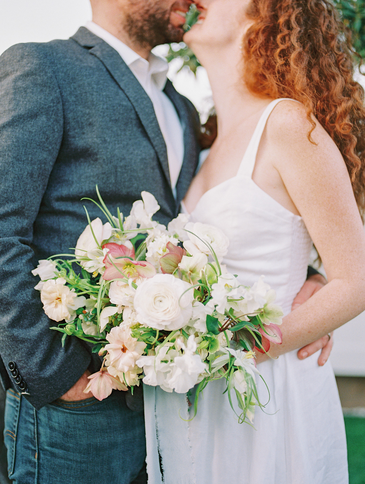 wedding couple in casual clothing kissing
