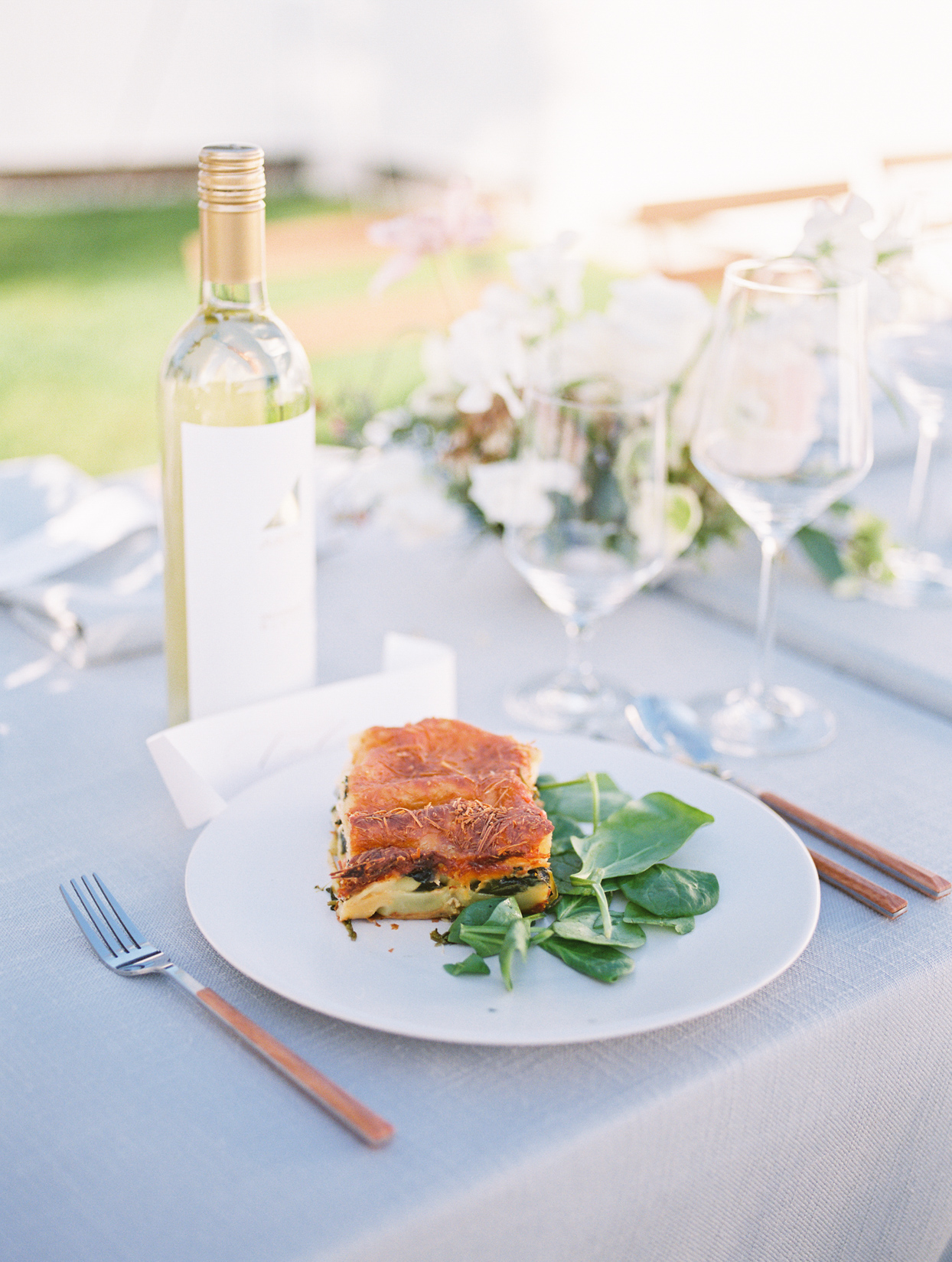 wedding food on white plate with pastel blue tablecloth