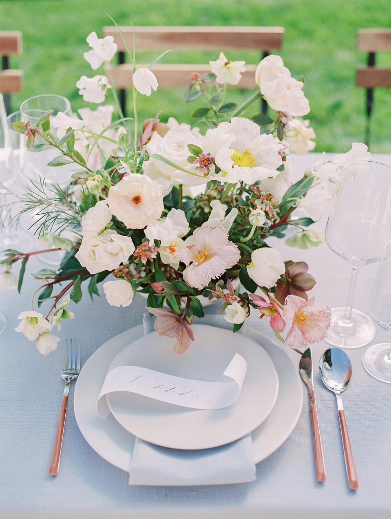 elegant wedding place setting with white places and pastels