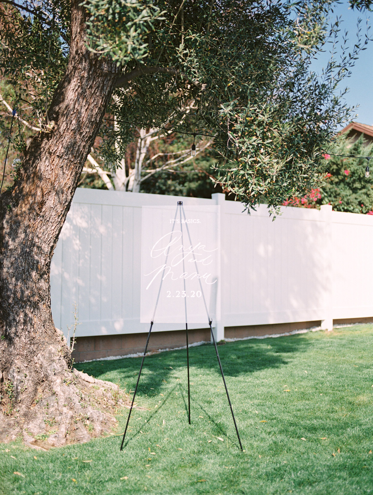 lucite sign for backyard wedding