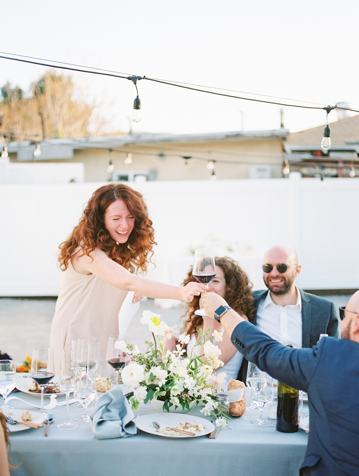bride's sister toasting at outdoor reception