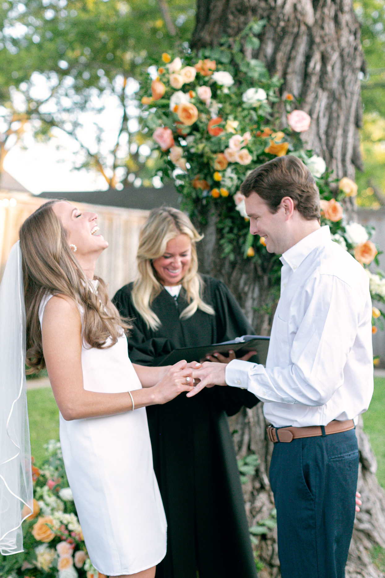 couple laughing during ring exchange at wedding ceremony