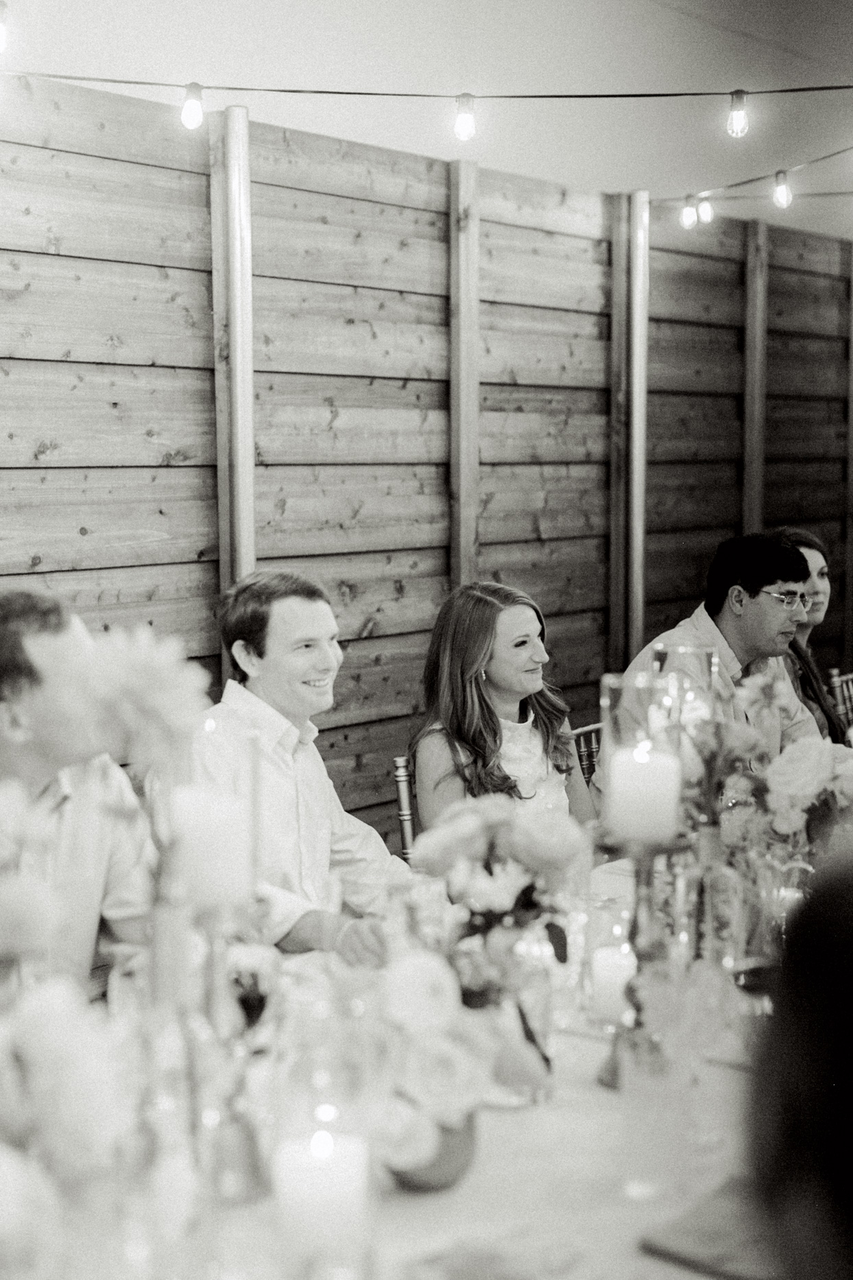 wedding couple smiling at reception table