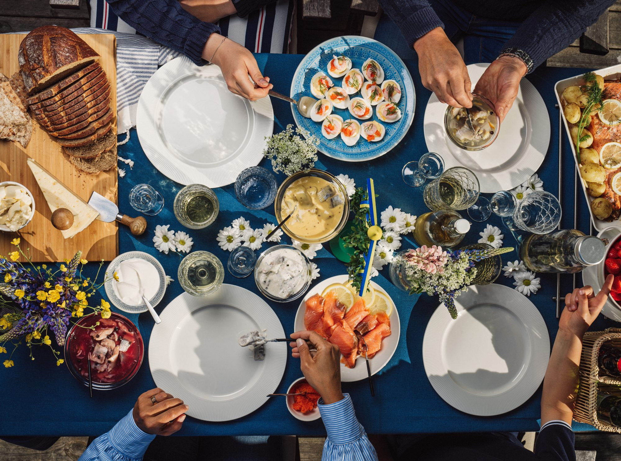 friends gathering around table outdoors