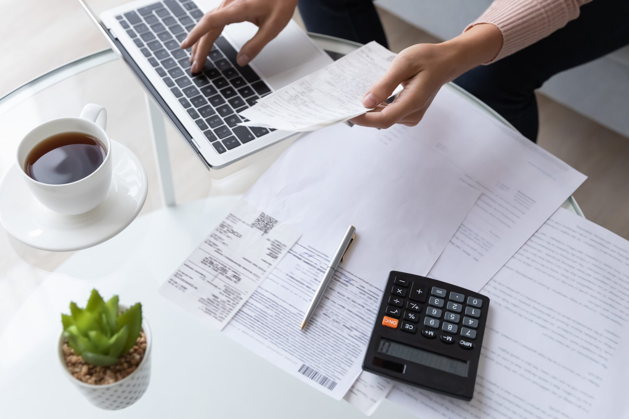 woman going over finances and paying bills online