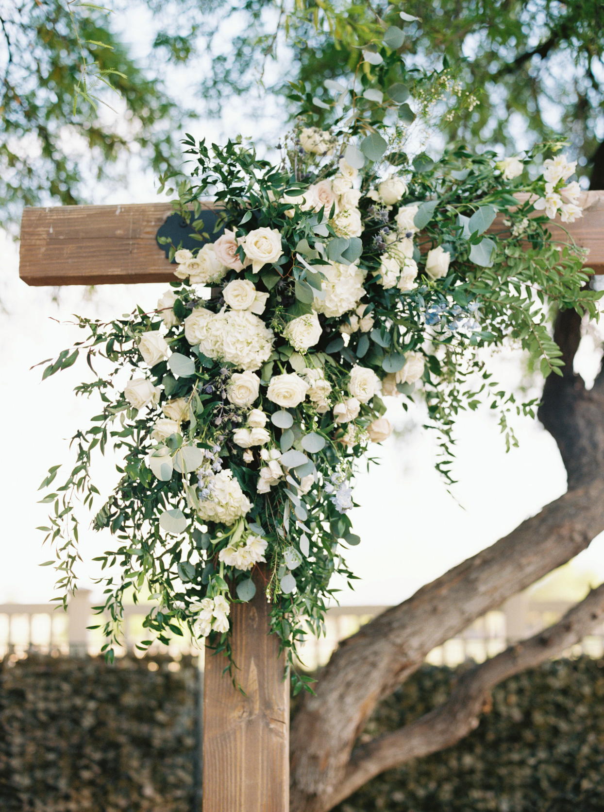 white flowers on the wooden ceremony arch