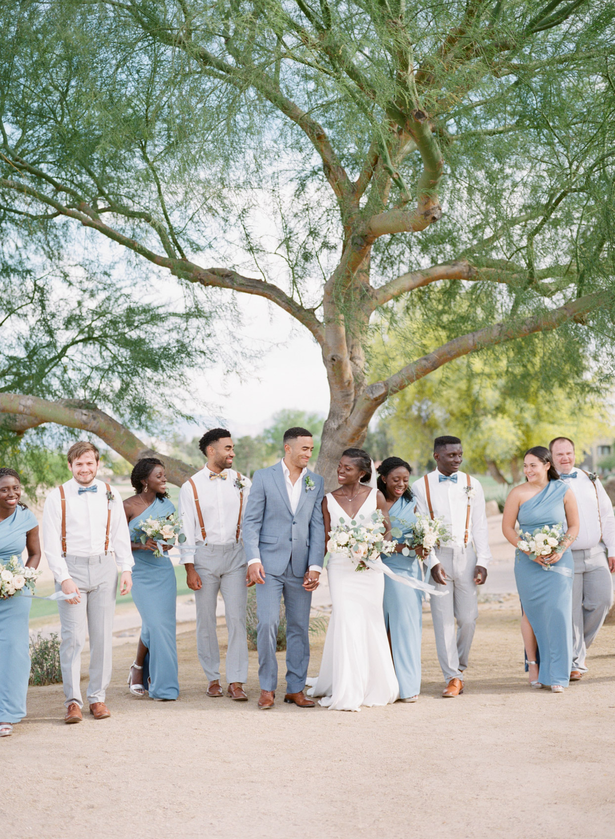 wedding party in white and blue outdoors