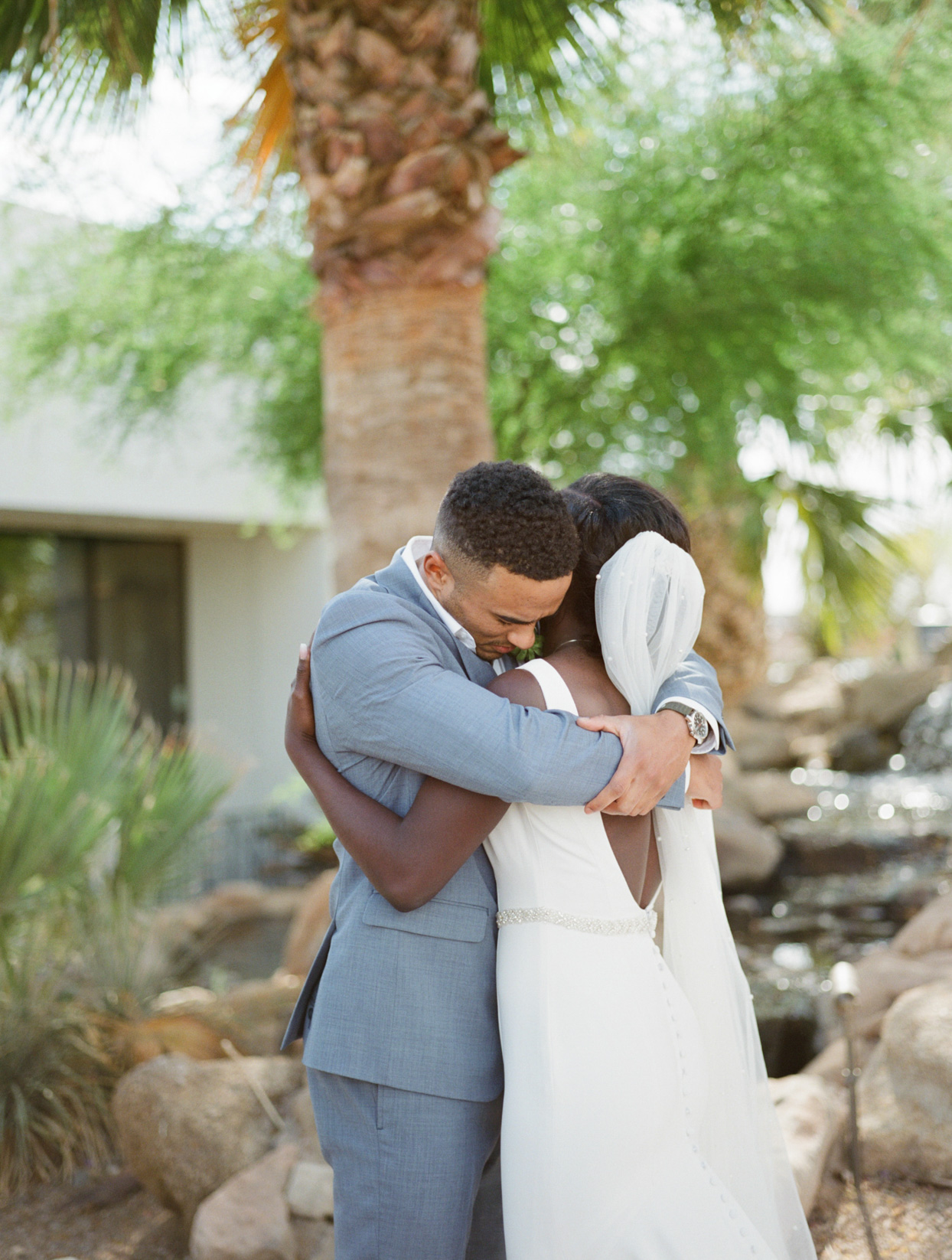 couple embracing during private wedding vows