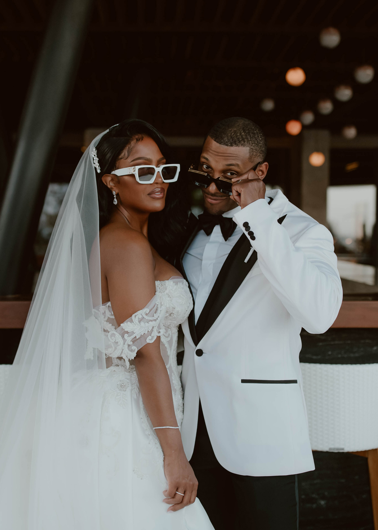 couple portrait in black and white wearing sunglasses