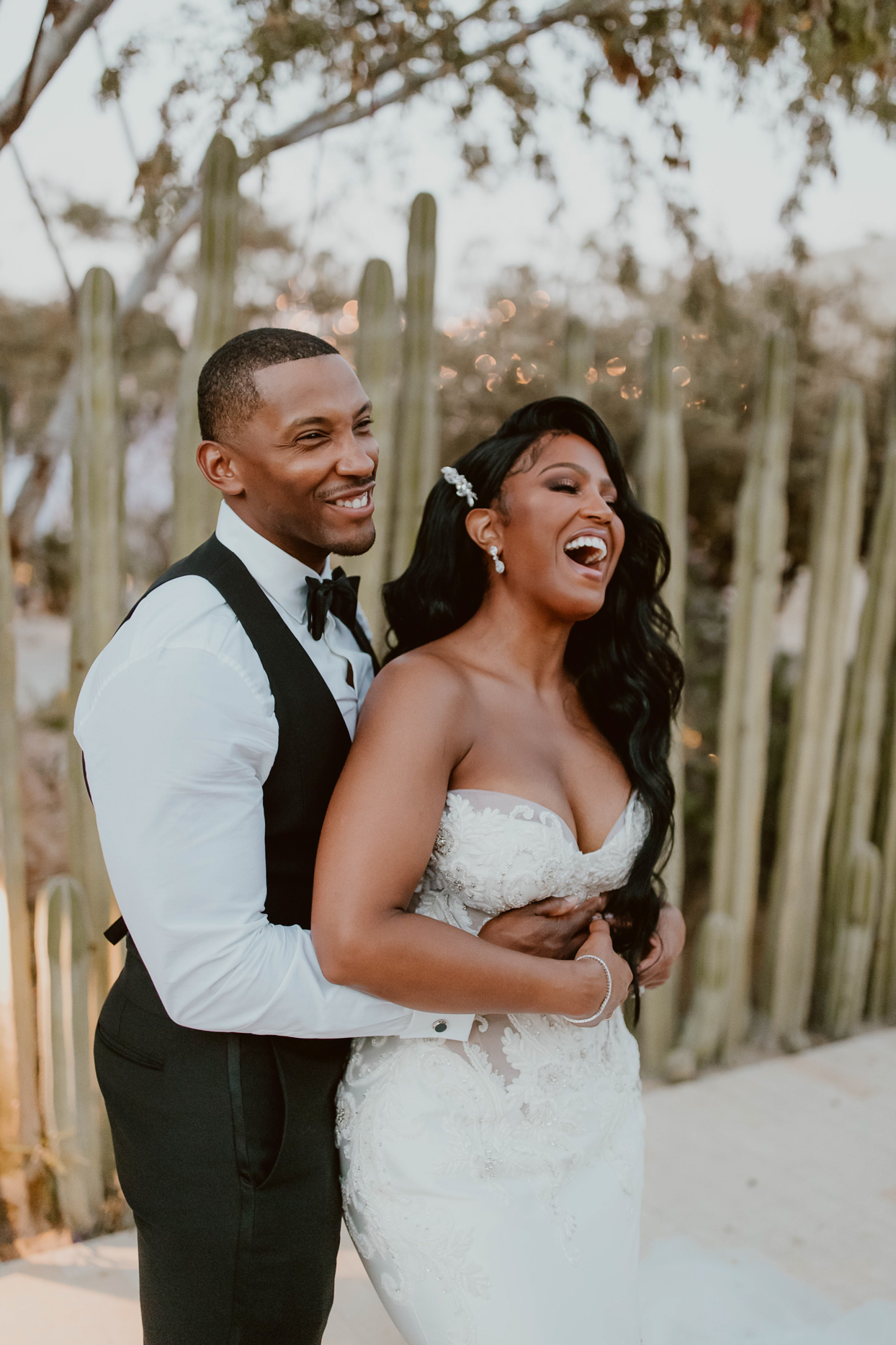 couple embracing and laughing at wedding reception