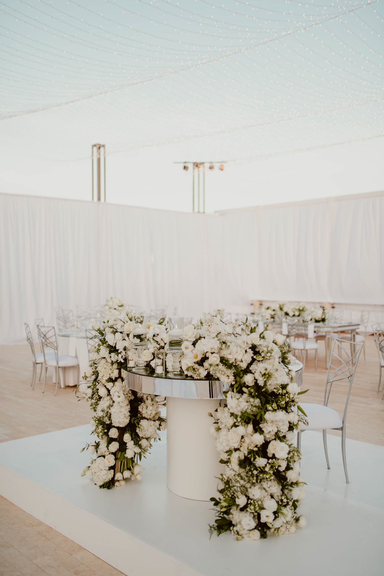 elegant sweetheart table with floral garland and mirror top