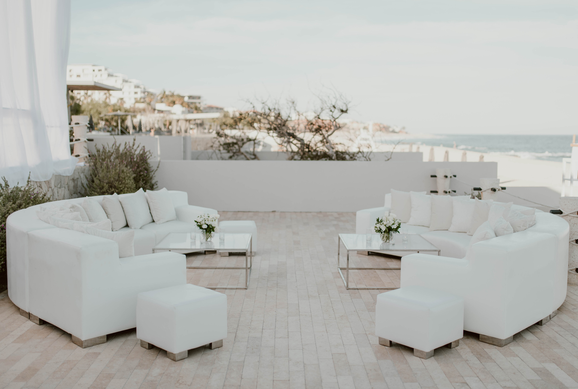 white curved couches reception lounge with beach view