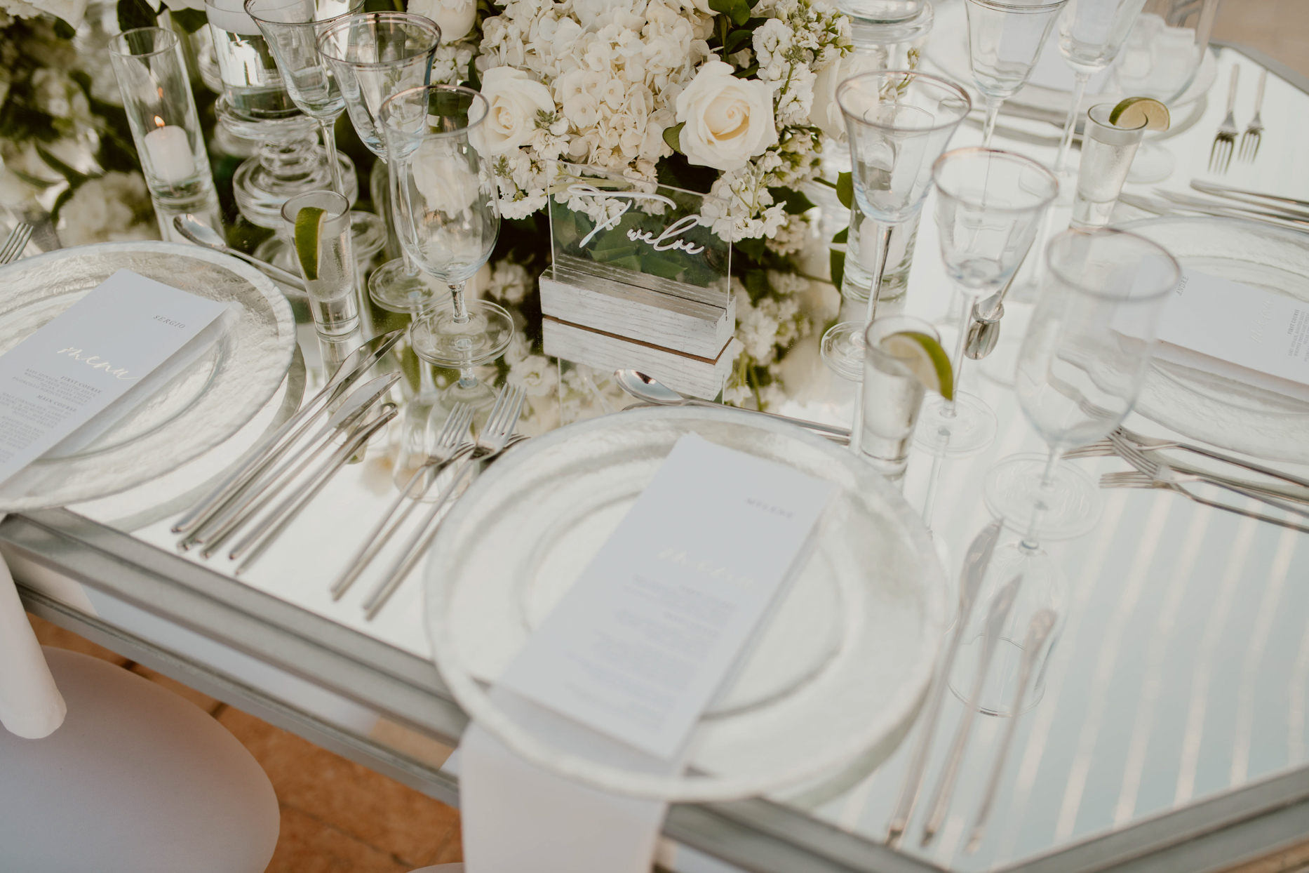 elegant white and silver wedding reception tables with mirror top