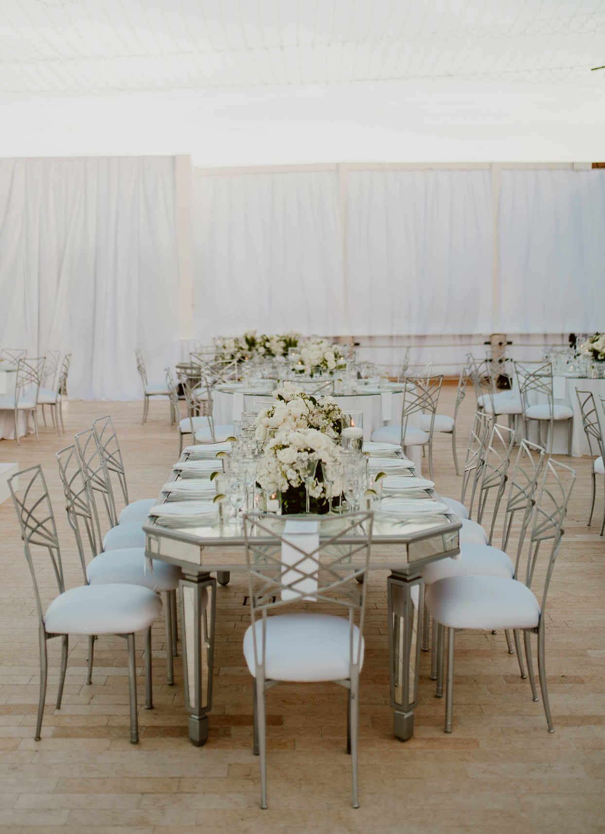 silver and white wedding reception tables