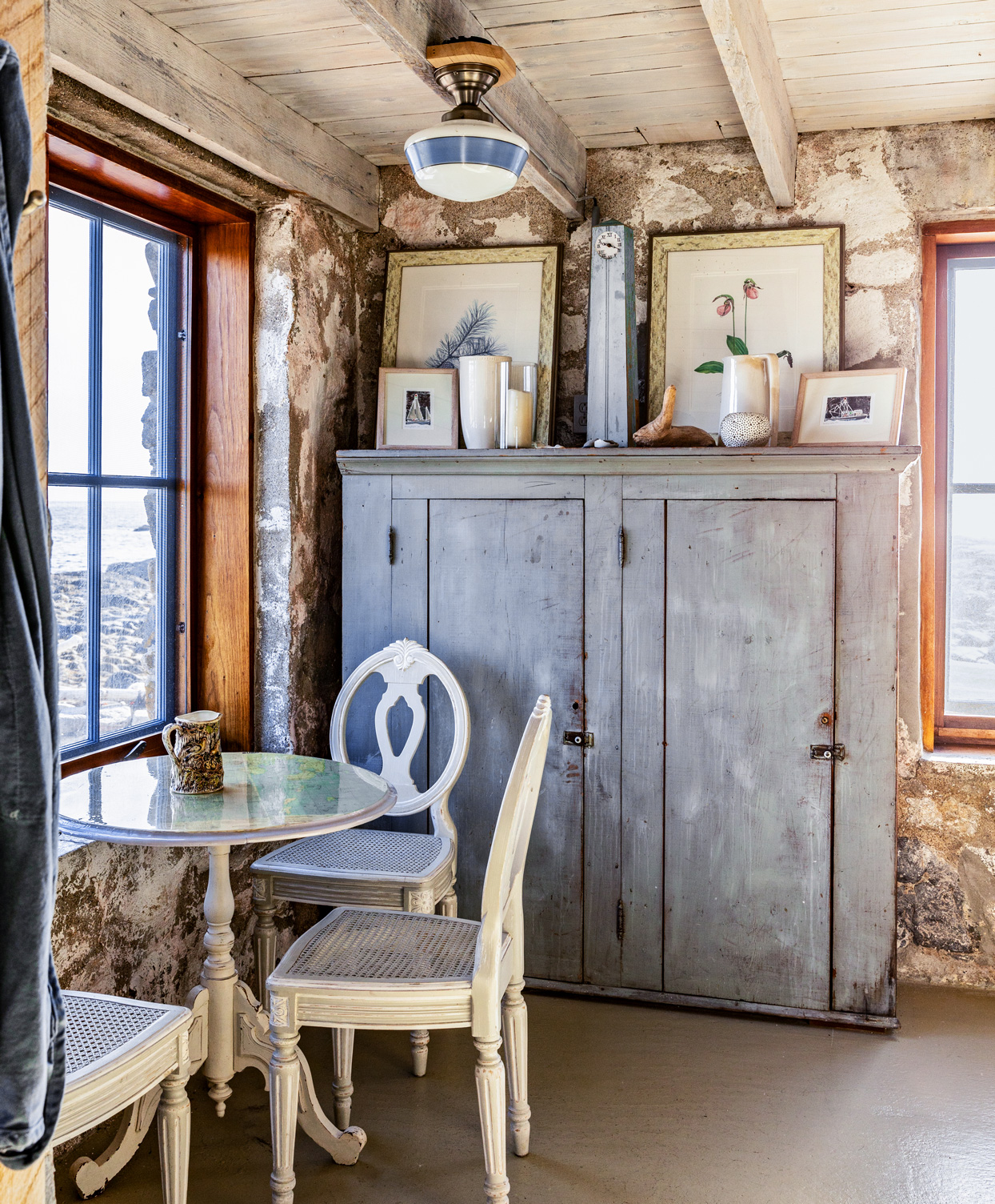rustic main house eating area overlooking harbor
