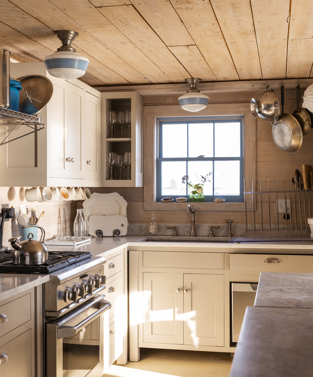 rustic main house kitchen with whitewashed cedar walls and ceiling